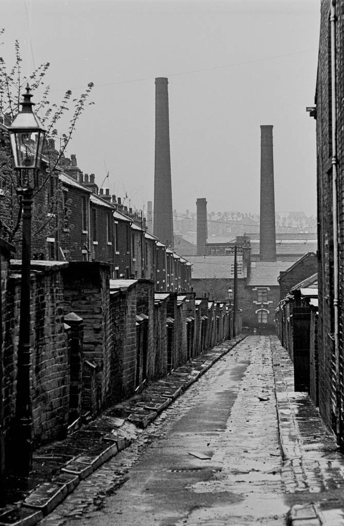 Bradford back alleyway and mill chimneys, 1969 29-25