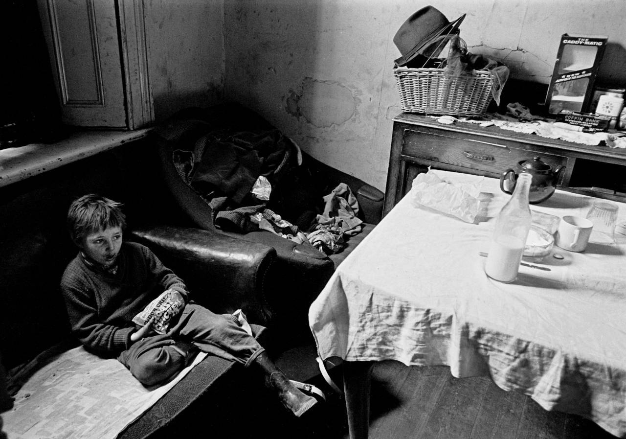 Child in his living room Newcastle 1971