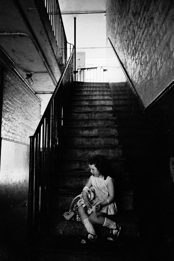 Child in stairwell, Rothschild Dwellings 1969