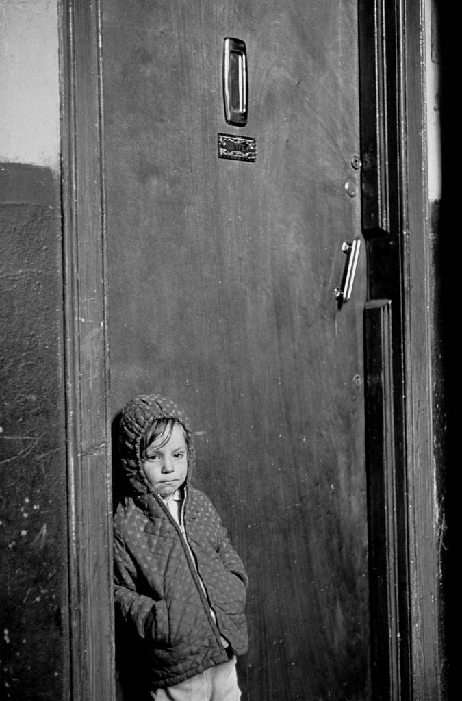 Child waiting for his parents to come home Glasgow tenement 1971
