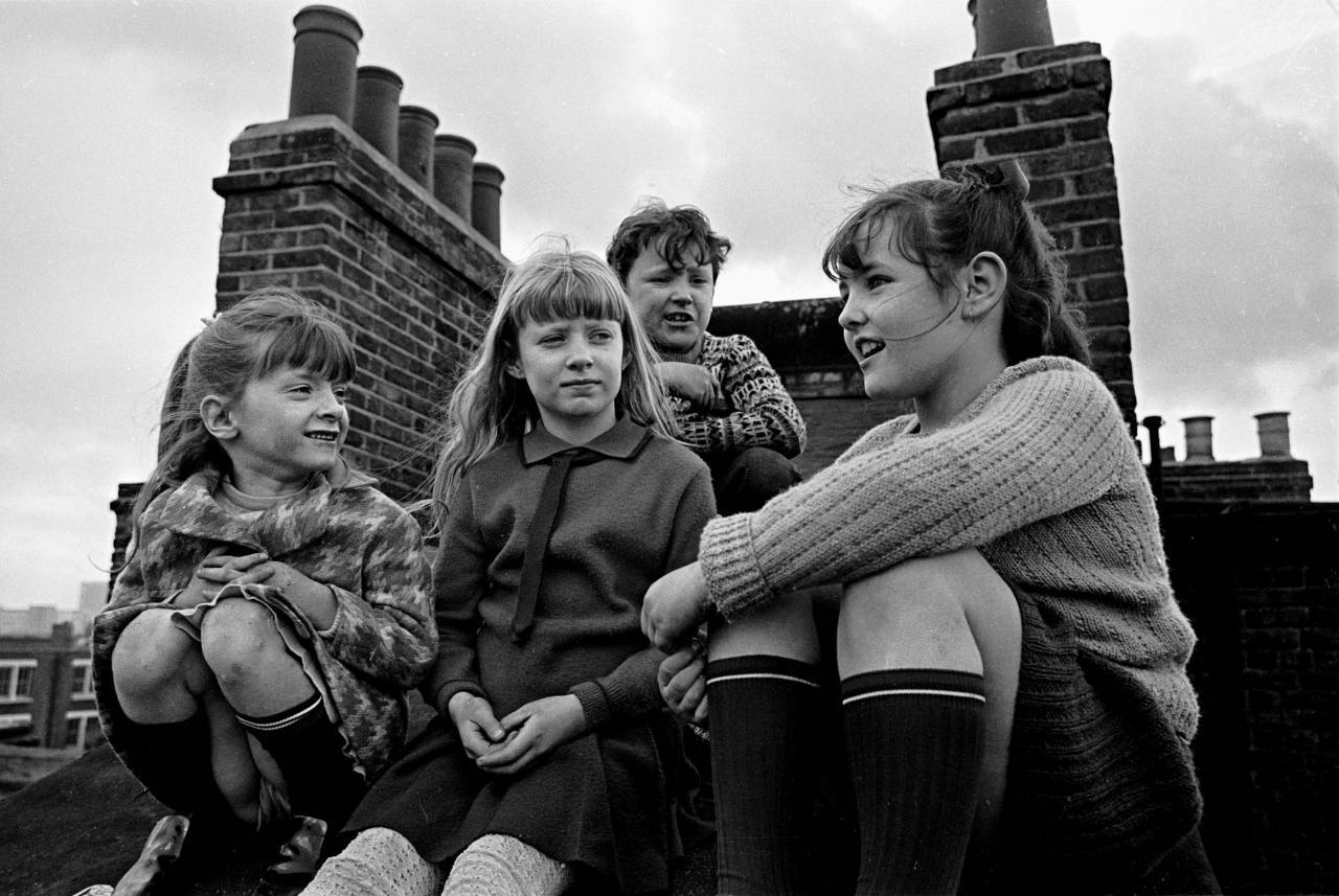 Children gossiping on the roof of their tenement block, Wandsworth 1969