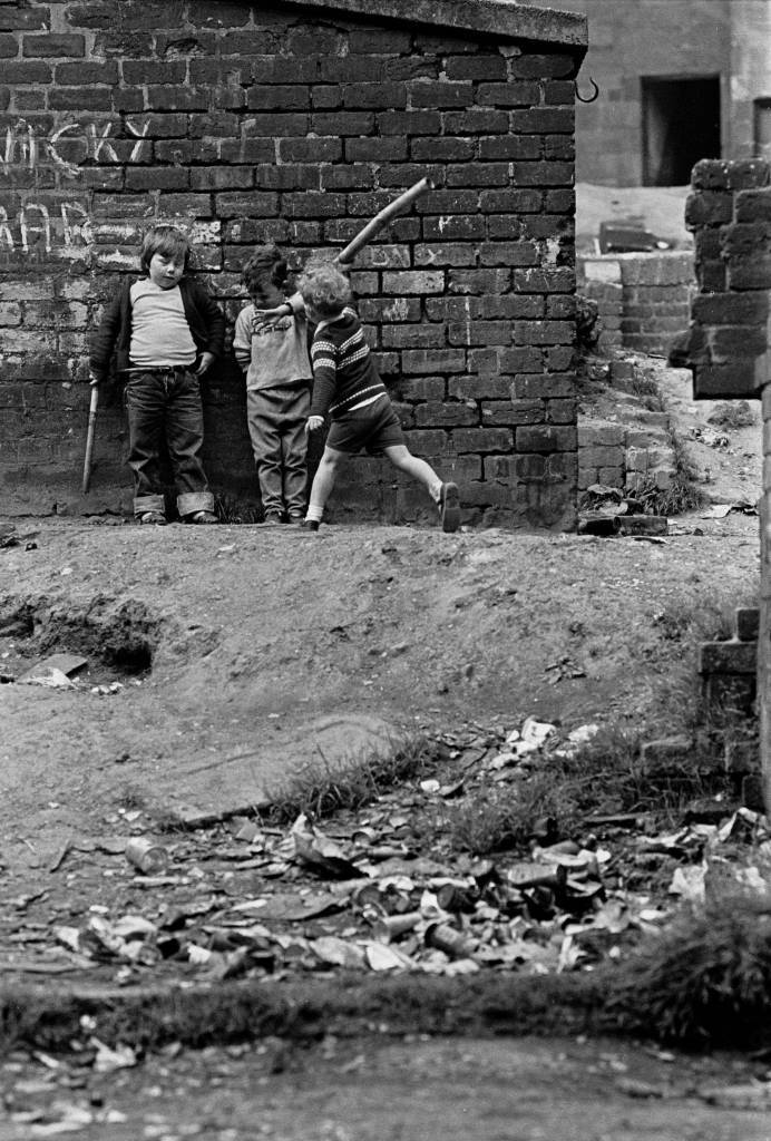 Children playing in a Glasgow tenement courtyard 1971