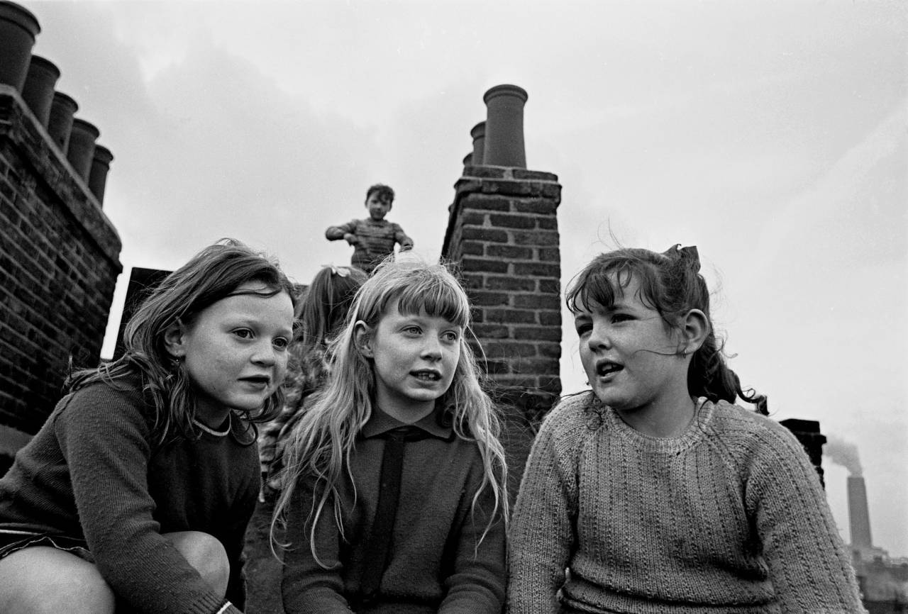 Children playing on the roof of their tenement block, Wandsworth 1969