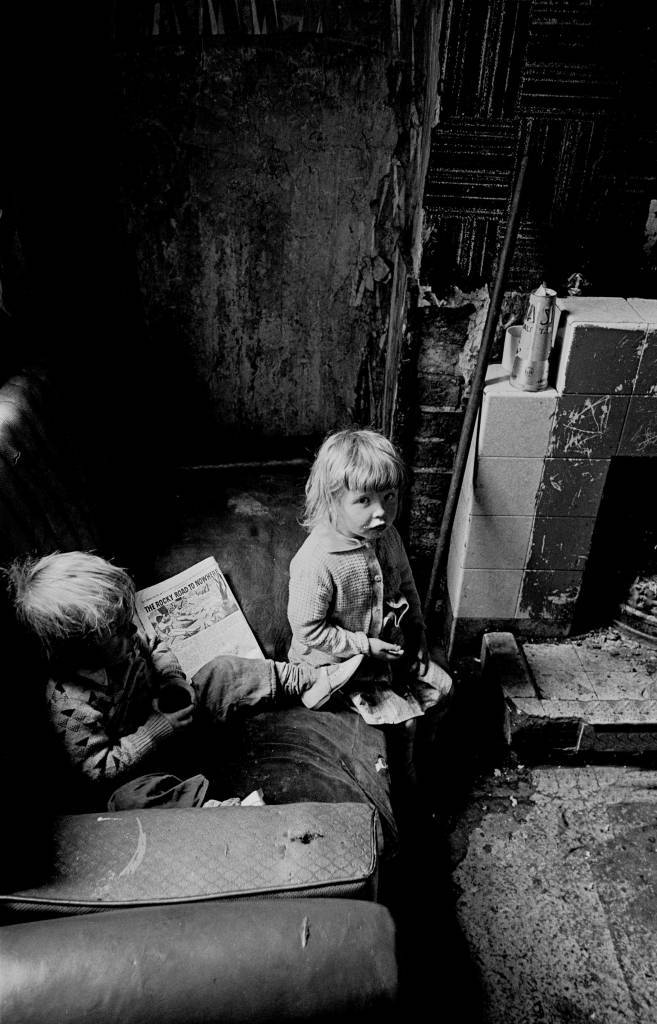 Children with comic in a Salford slum property 1971