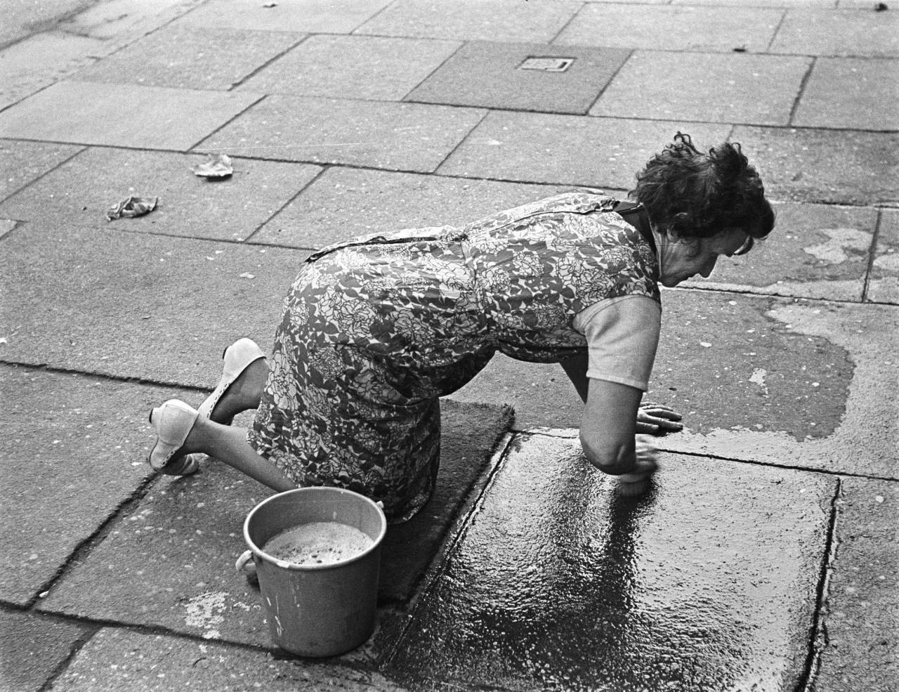 Cleaning the pavement outside my house Liverpool 8 1969