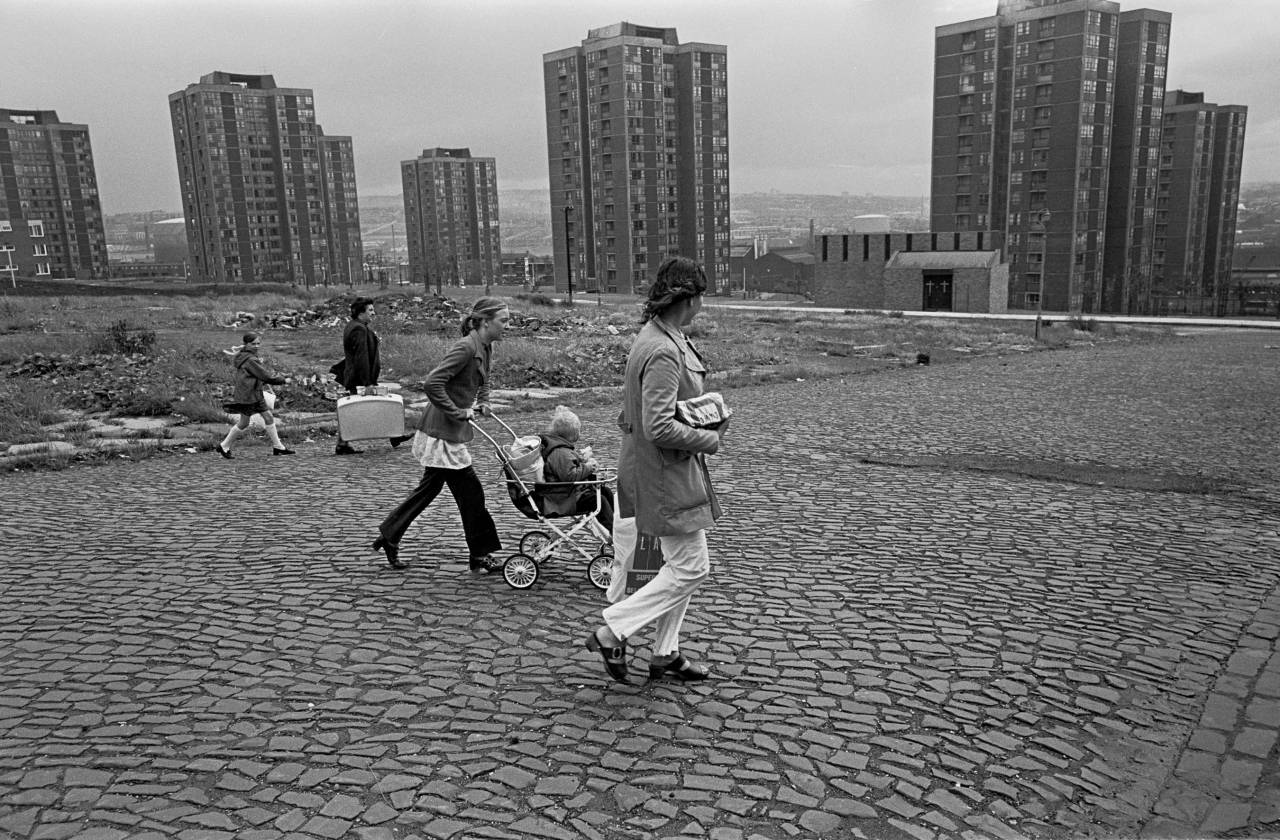 Families wlking across slum clearance site Newcastle upon Tyne 1972