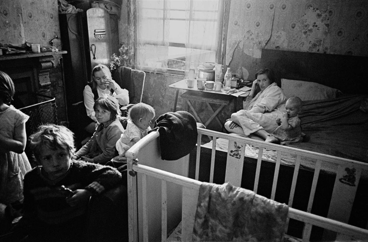 Family living in a single room Moss Side, 1969