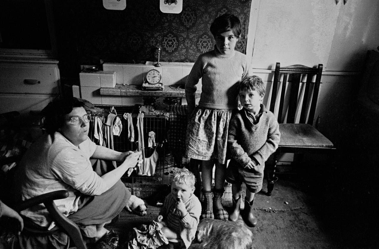Family living in an overcrowded property, Bradford 1969