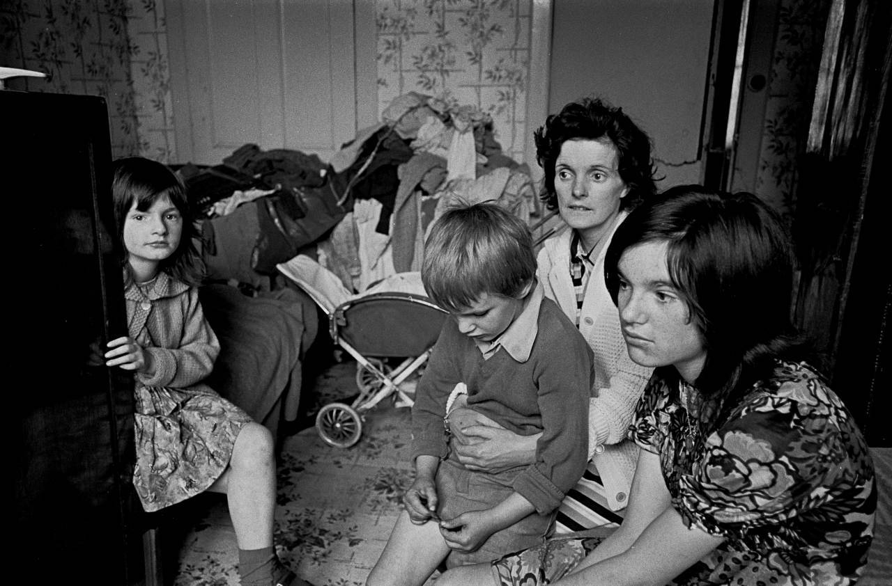Family living in an overcrowded tenement flat Glasgow 1971