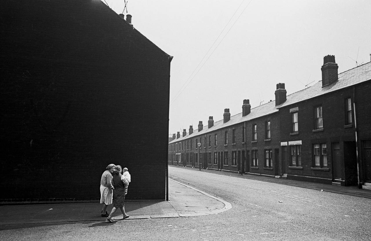 Family walking round the corner, Sheffield 1969