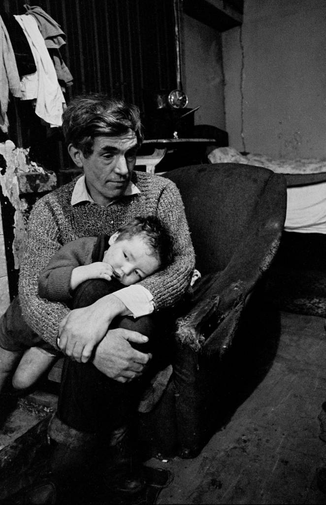 Father and babe in a Gorbals slum tenement 1970