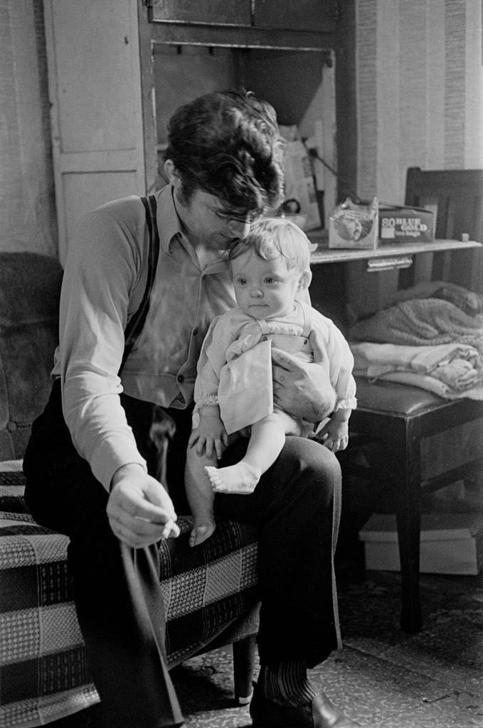 Father and child in a Maryhill tenement 1971
