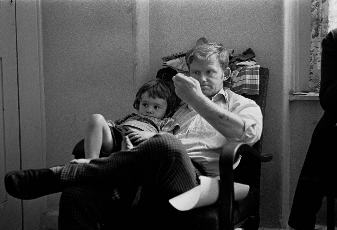 Father and child in a hostel for the homeless London 1971