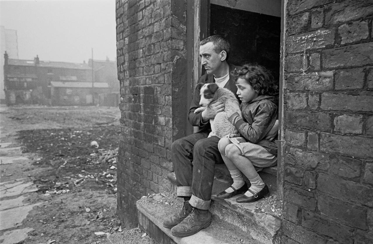 Father and daughter on the front step of their house Liverpool 8 1969