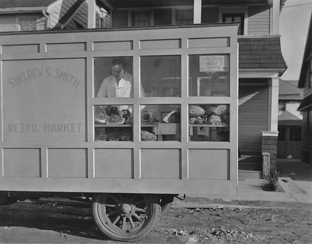 A man in a mobile butcher and grocery store circa 1940. (Photo by Keystone View/FPG/Getty Images)