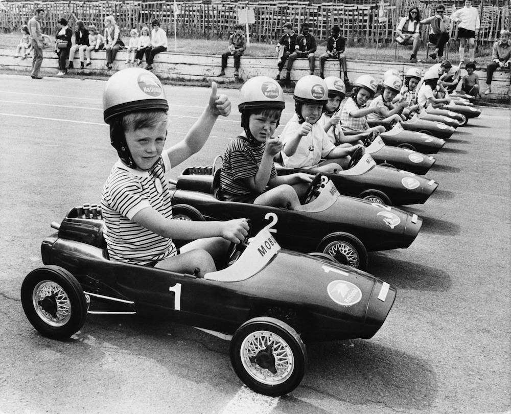 Competitors line up for the start of the RAC Junior Grand Prix at Crystal Palace, London, 7th June 1970. Open to boys and girls aged 6 and under, the race was a 75-yard dash in pedal-powered cars. (Photo by Frank Barratt/Keystone/Getty Images)