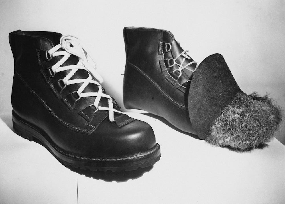 Boots being handmade for Edmund Hillary's Mount Everest expedition, 21st January 1953. The boot on the right is still under construction, and the fur interlining can be seen. They are being made by Messrs. Robert Lawrie Ltd of London, and should be durable at heights of 23,000 feet. (Photo by Ron Burton/Keystone/Getty Images)