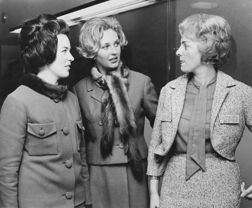 Presenter Katie Boyle (centre) chats to Eurovision Song Contest entrants Laila Halme of Finland (left) and Annie Palmen of the Netherlands (right) at the BBC Television Centre in London, 21st March 1963. (Photo by Central Press/Hulton Archive/Getty Images)