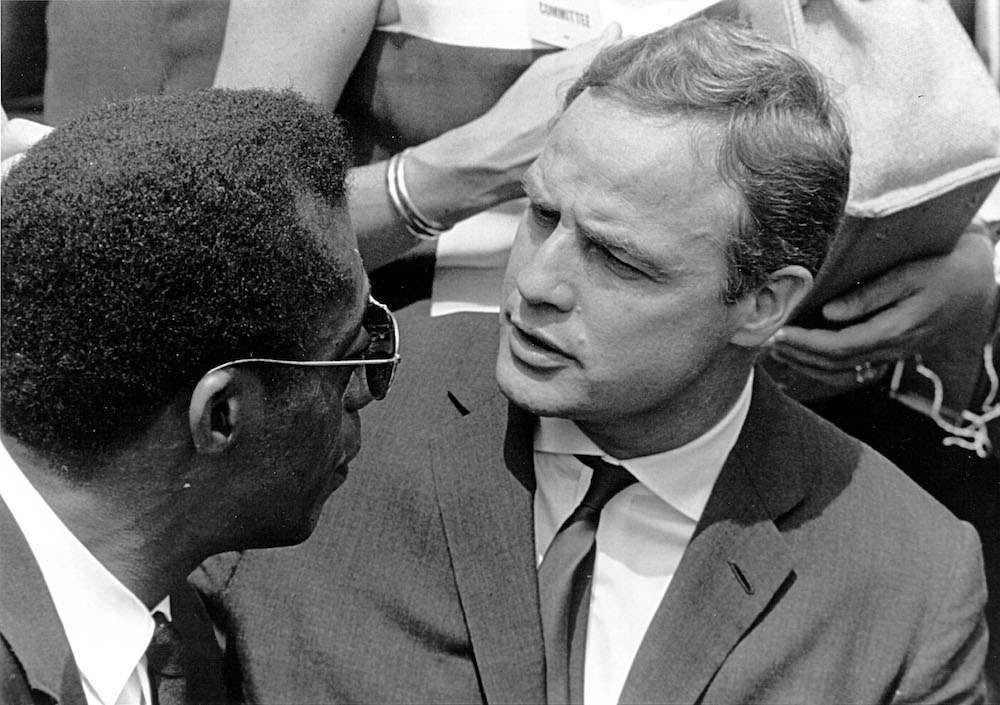 Actor Marlon Brando speaks to the writer James Baldwin at a civil rights rally August 28, 1963 in Washington, D.C. (Photo by National Archive/Newsmakers)