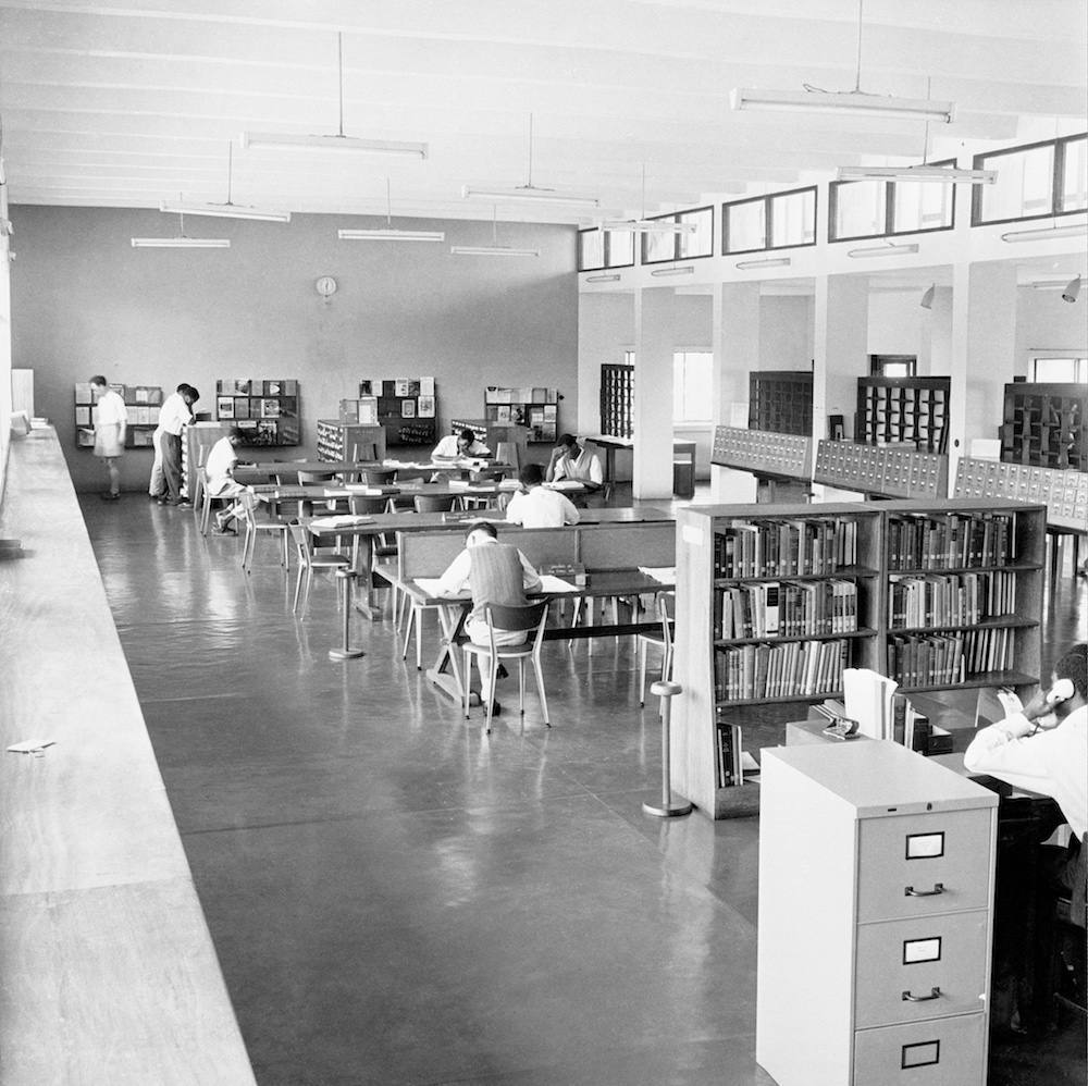 The reference section of the Kenneth Dike Library at the University College of Ibadan, later the University of Ibadan, in Nigeria, cira 1955. (Photo by Three Lions/Hulton Archive/Getty Images)