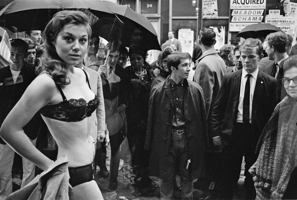 A model taking part in a risque photoshoot in the window of a new Henry Moss boutique in Carnaby Street, London, 11th May 1966. (Photo by John Downing/Daily Express/Hulton Archive/Getty Images)