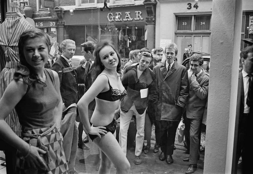 Models Diane James and Jina Baker take part in a risque photoshoot in the window of a new Henry Moss boutique in Carnaby Street, London, 11th May 1966. (Photo by John Downing/Daily Express/Hulton Archive/Getty Images)