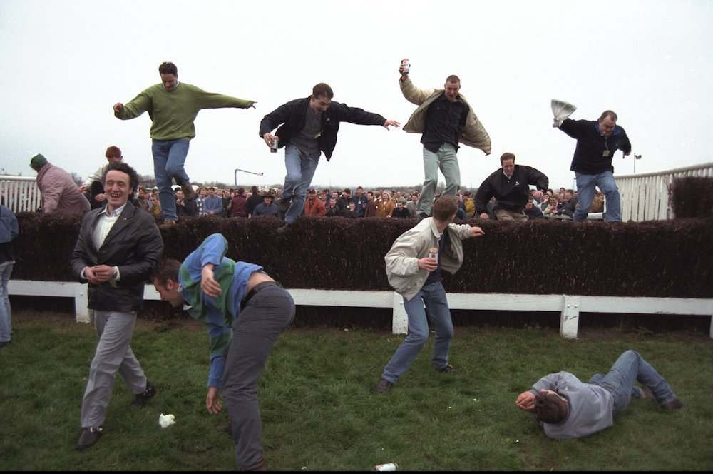 5 Apr 1997:  The crowd sieze the opportunity to jump the famous fences at Aintree due to the evacuation of the stands, caused by the IRA bomb scare which postponed The Grand National to April 7th at the Aintree Racecourse, Liverpool, England.  MandatoryCredit: David Rogers /Allsport
