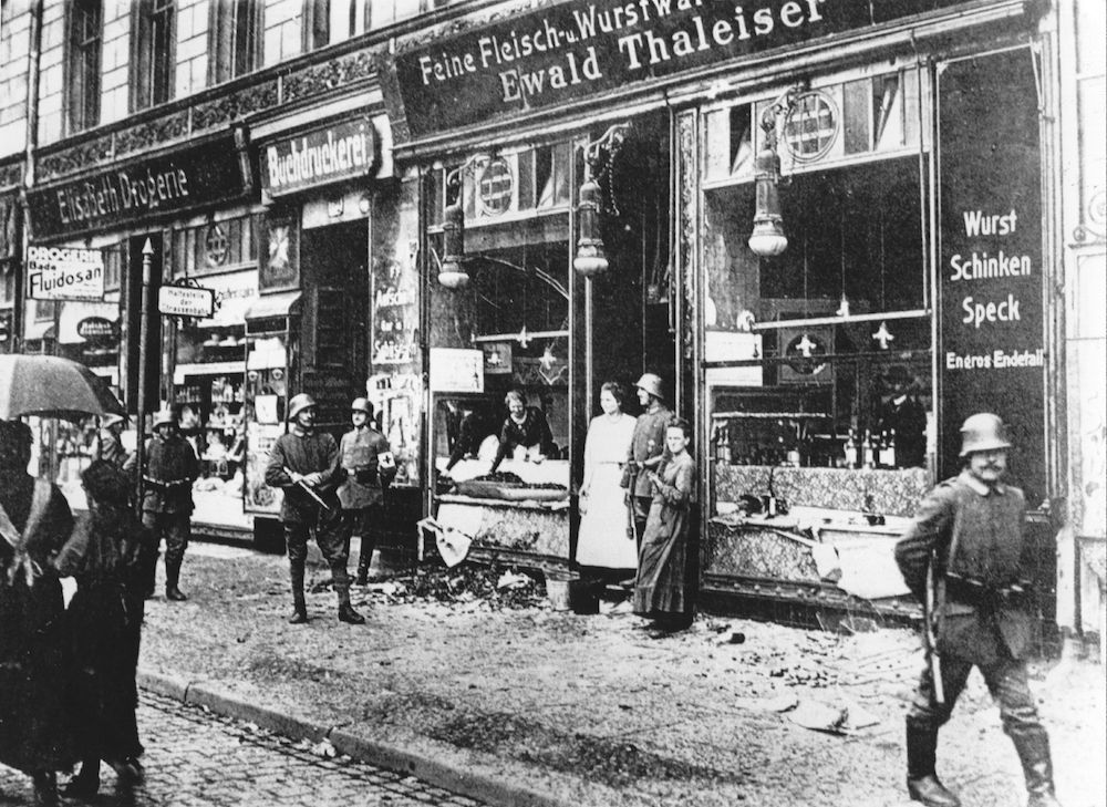 German soldiers guard a butcher's shop in Hamburg, looted during the uprisings which broke out following Germany's defeat in World War I. (Photo by Three Lions/Getty Images)