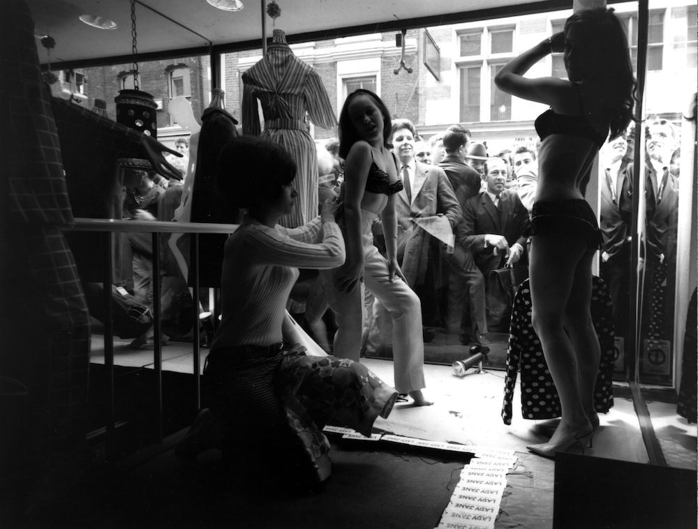 Live models being dressed in the window of the Carnaby Street boutique 'Lady Jane'. (Photo by Evening Standard/Getty Images)