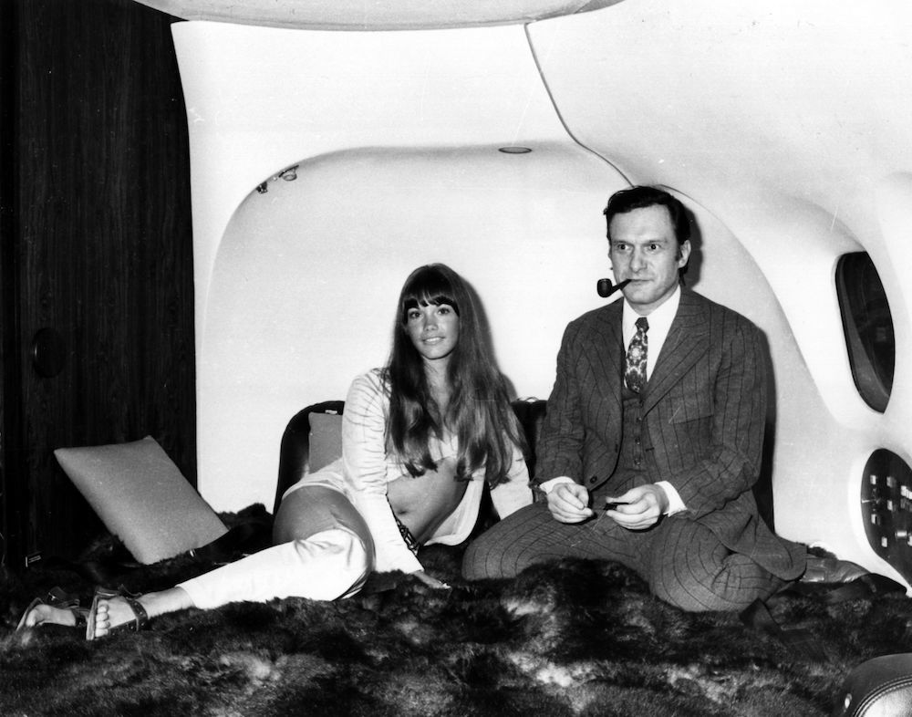 The president of Playboy Enterperises, Hugh Hefner with girlfriend, Barbi Benton in his luxury DC-9 aircraft 'The Big Bunny' at Heathrow. The couple are en route to an extended holiday around Europe. (Photo by Keystone/Getty Images)