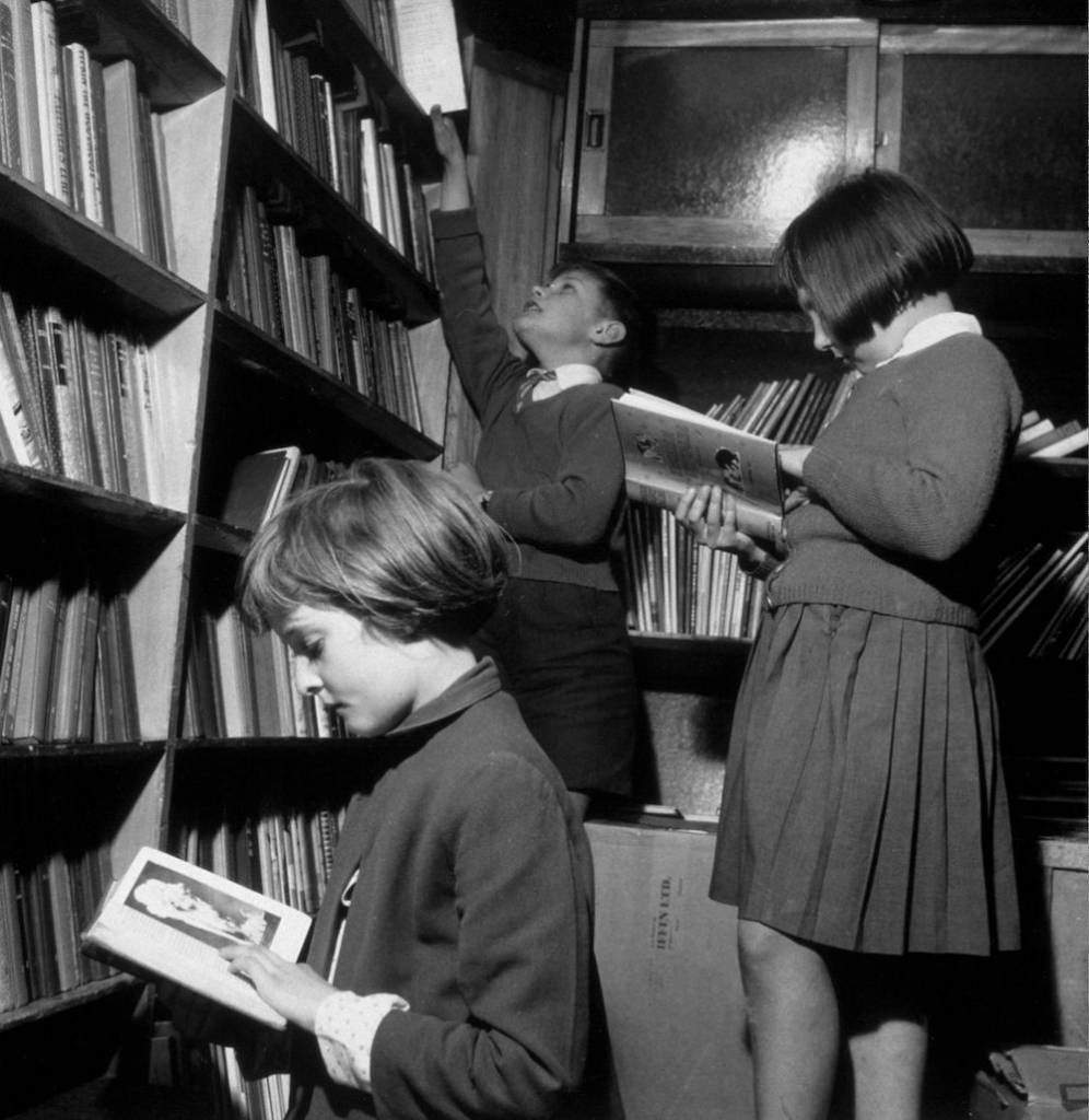 Schoolchildren choosing books from a mobile library van. (Photo by Keystone/Getty Images)