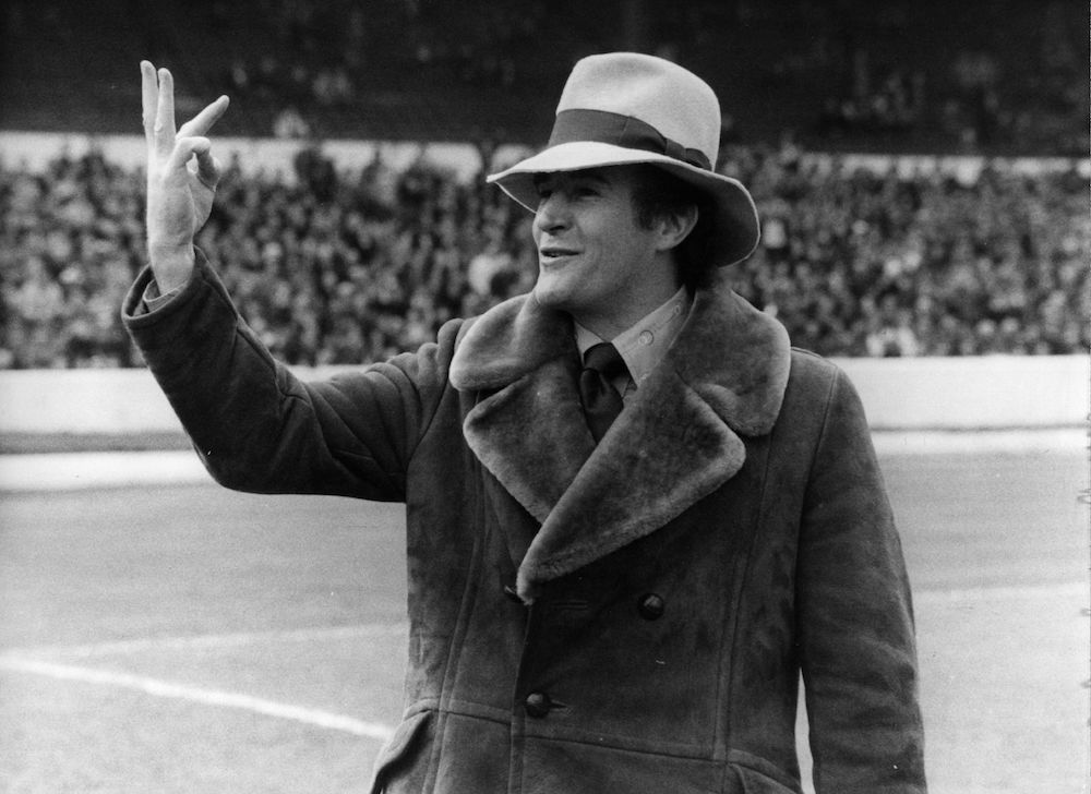 Crystal Palace manager Malcolm Allison holding up three fingers to the Chelsea fans, at Stamford Bridge football ground, London, forewarning them of the final score. Crystal Palace won the match 3 - 2. (Photo by Central Press/Getty Images)