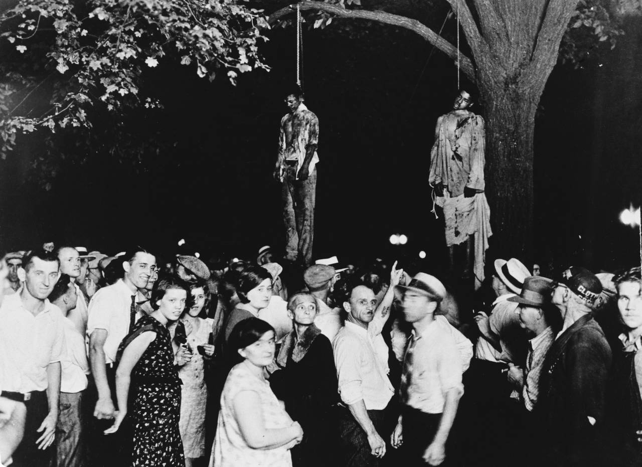 A crowd gathering to witness the killing of Thomas Shipp and Abram Smith, two victims of lynch law in Marion, Indiana, 7th August 1930. This image was the inspiration for the poem 'Strange Fruit' by Abel Meeropol.