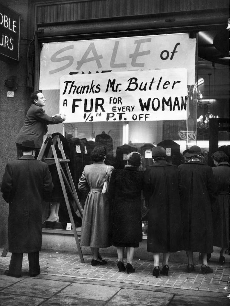 Women looking in the window of a clothes shop in Regent's Street, London, where, thanks to a tax cut, fur coats are on sale at two-thirds of their previous price. (Photo by Harrison/Getty Images)