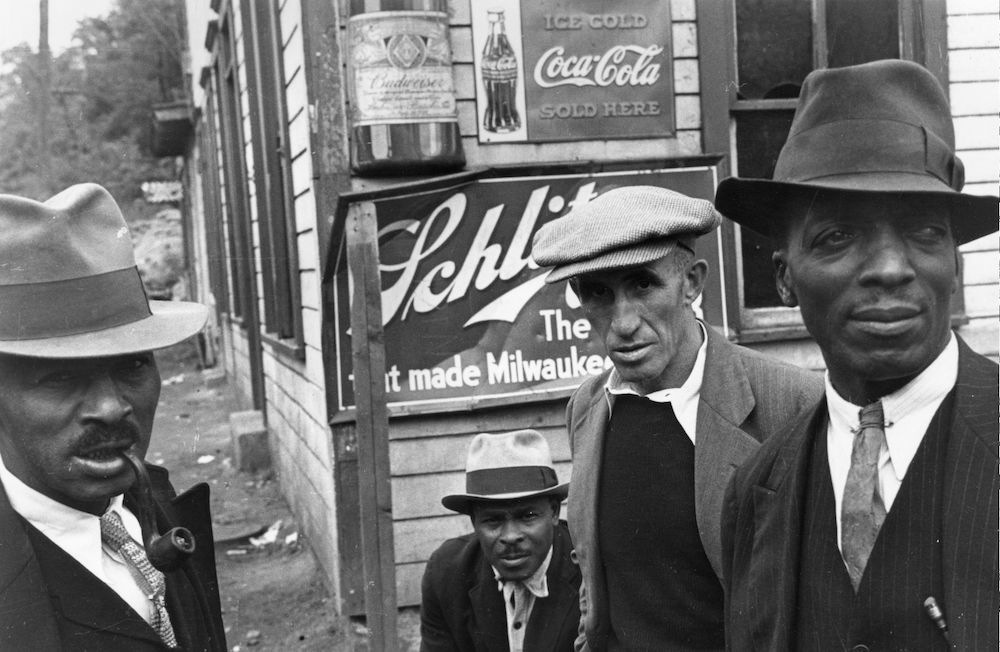 A group of men in the coal mining area of Scott's Run, West Virginia. (Photo by Ben Shahn/Getty Images)