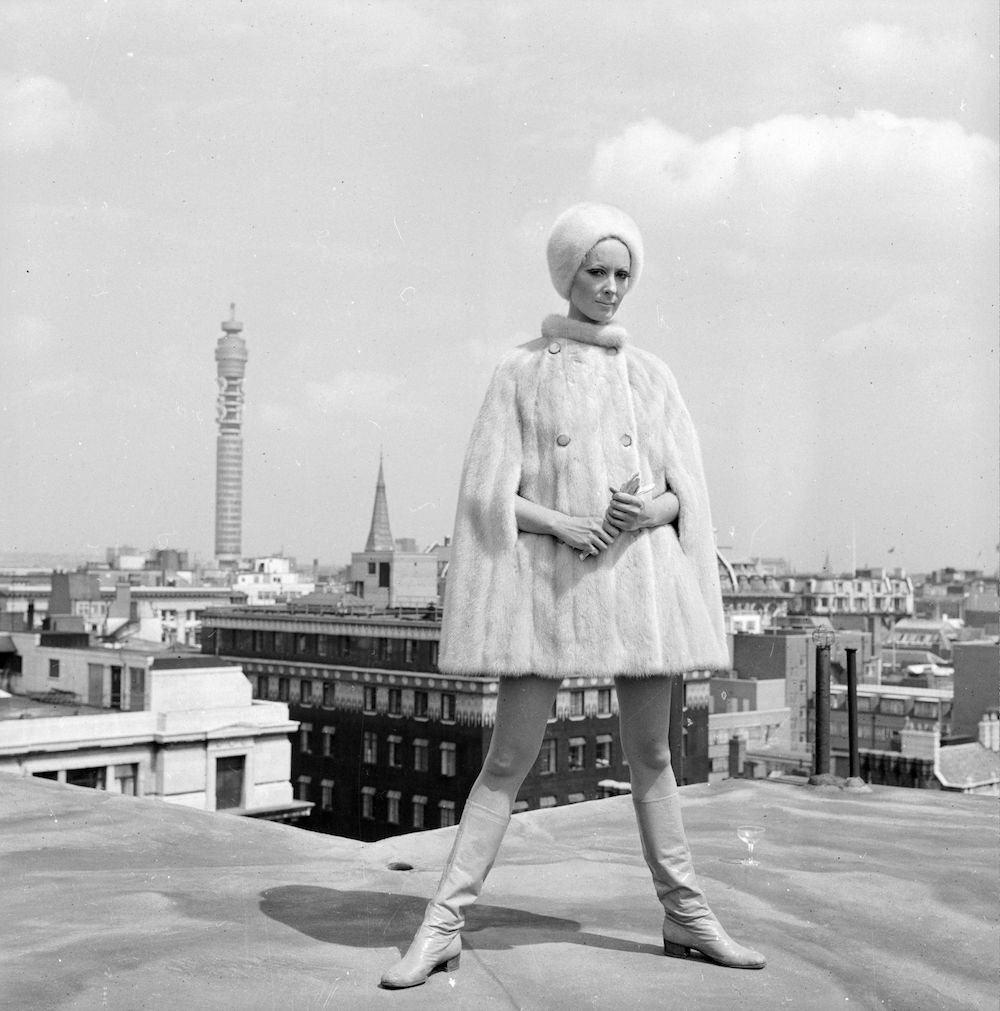 18th July 1967: Ruth Dumer models a white mink cape and hat costing ?756 on a rooftop near the Post Office Tower. (Photo by Harry Dempster/Express/Getty Images)
