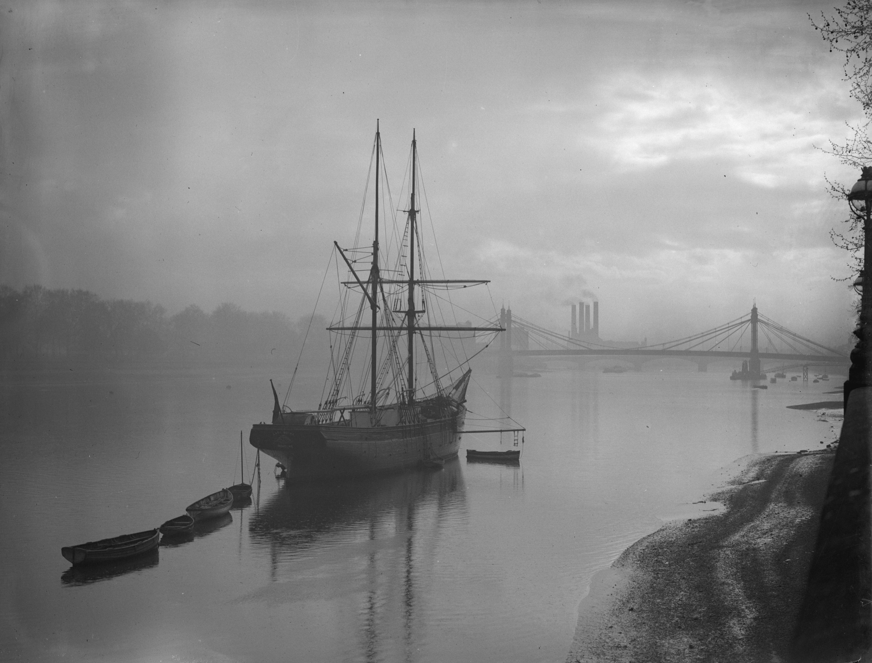 April 1934: A Navy cadet training ship on the Thames at Battersea, London with Albert bridge in the background. (Photo by Fox Photos/Getty Images)