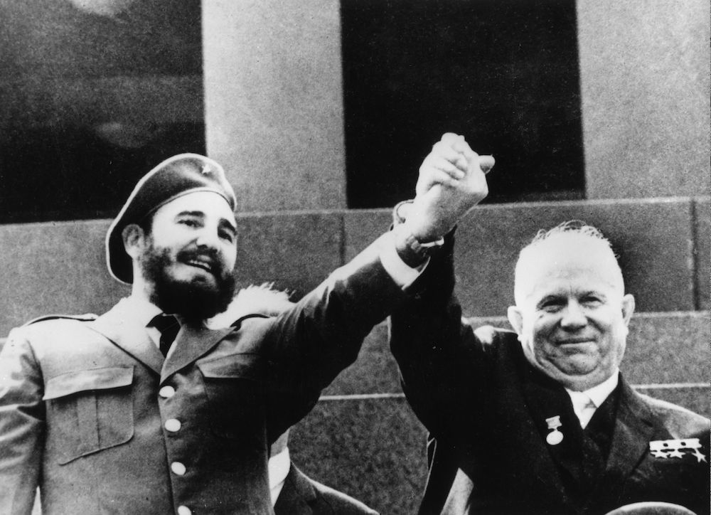 7th May 1964:  Cuban revolutionary Fidel Castro with Soviet premier Nikita Khrushchev (1894 - 1971) at the Lenin Mausoleum in Red Square, Moscow.  (Photo by Hulton Archive/Getty Images)