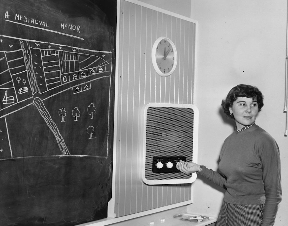 7th October 1954:  Schoolteacher Jean Breht switches on the loudspeaker in her classroom at London County Council's first comprehensive high school at Kidbrooke in Greenwich.  (Photo by Harry Todd/Fox Photos/Getty Images)