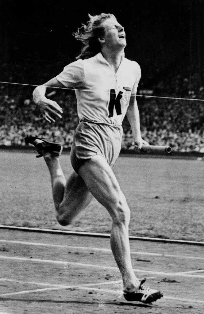 7th August 1948:  Fanny Blankers-Koen of Holland wins the last lap of the 4x100 metres relay, giving the Netherlands the gold medal at the 1948 London Olympics.  (Photo by Keystone/Getty Images)