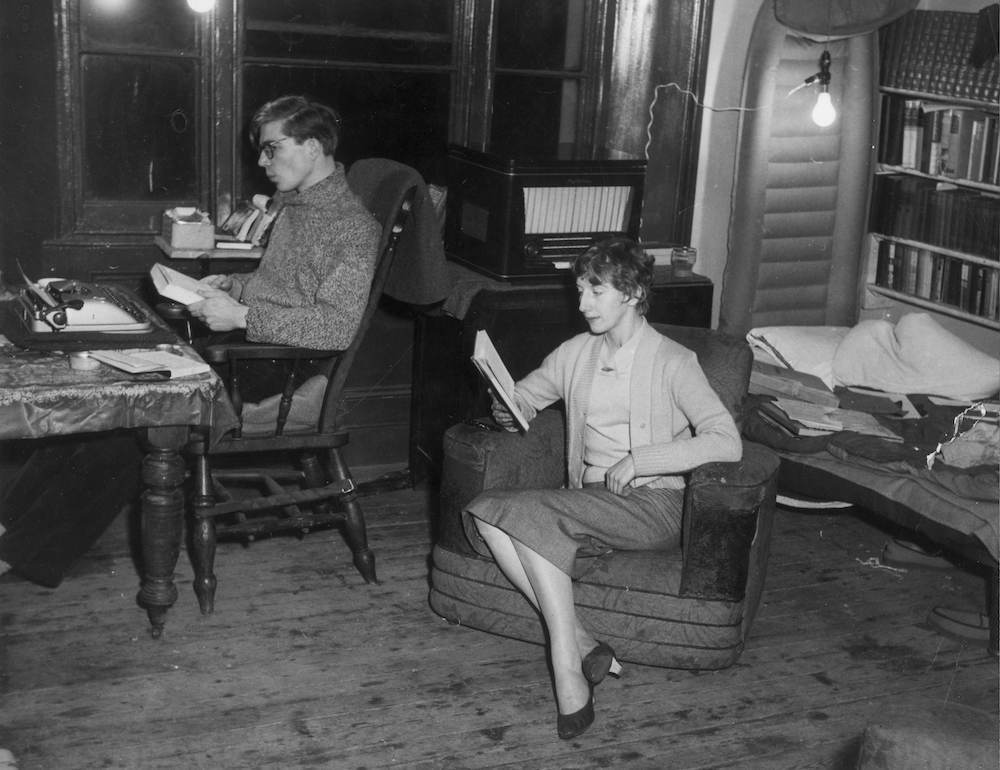 7th March 1957:  Author Colin Wilson and Joy Stewart in their sparsely furnished London bedsitting flat.  (Photo by Keystone/Getty Images)