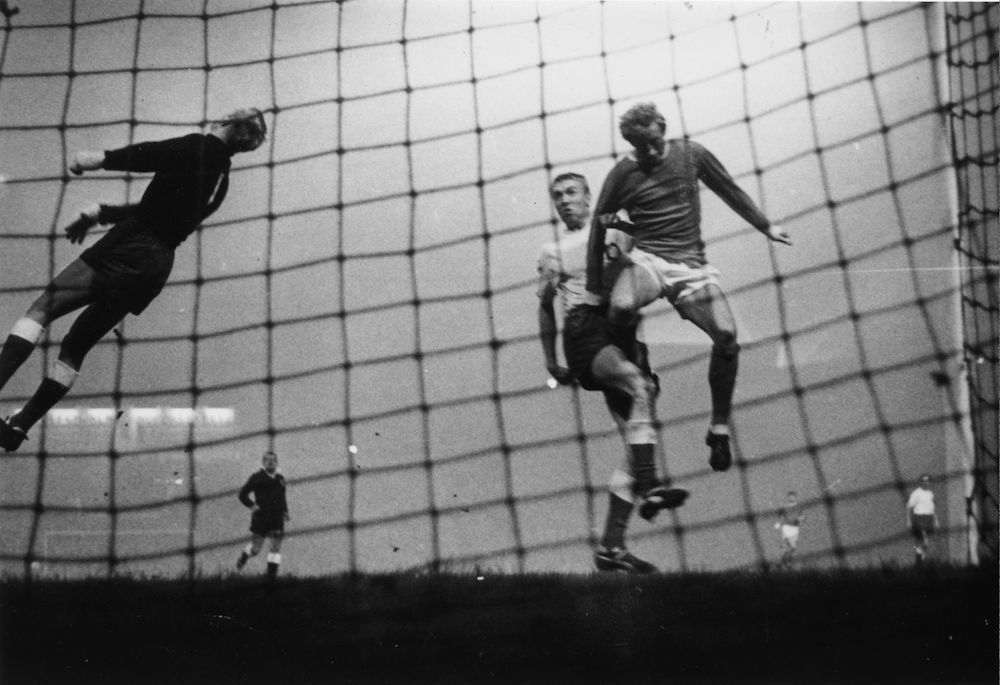 7th October 1965:  Manchester United forward Denis Law fails to score when the Helsinki goalkeeper saves the goal during a European Cup match between Man United and Helsinki. Nonetheless Man U won by 6-0.  (Photo by Keystone/Getty Images)