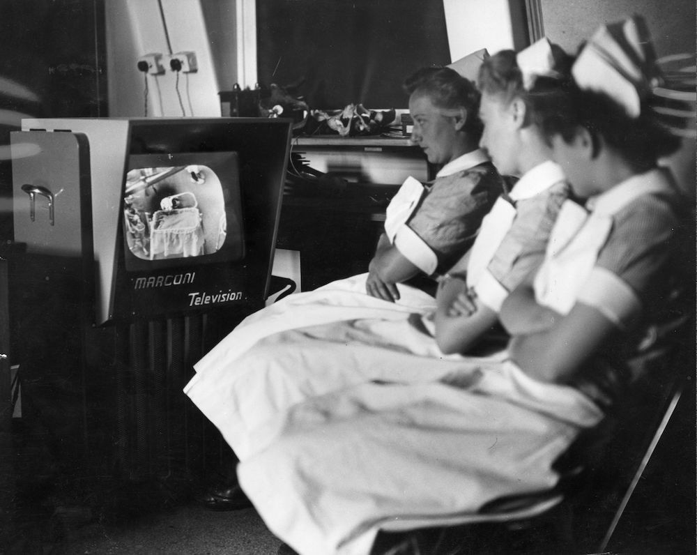 7th July 1949:  Nurses at an International Gynaecological congress in University College Hospital, London watching an operation on a Marconi television.  (Photo by Fox Photos/Getty Images)