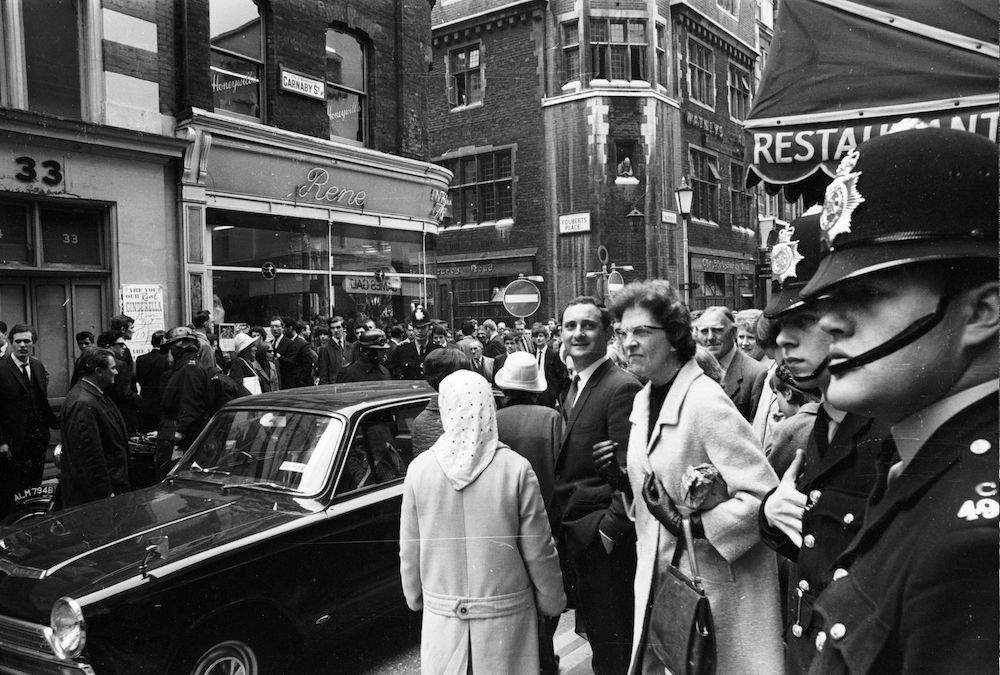 11th May 1966: Police arrive at Carnaby Street in London to question boutique owner Henry Moss and models Diane James and Jina Baker after they caused congestion in the street by changing clothes in the shop window. (Photo by McKeown/Express/Getty Images)