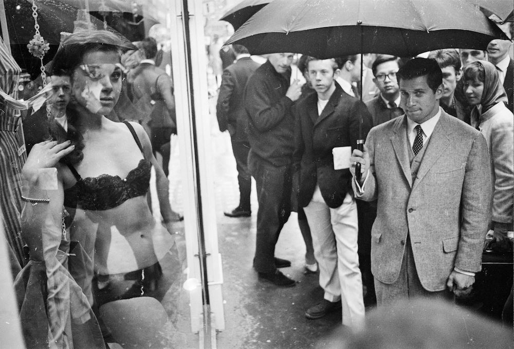 11th May 1966: A model takes part in a raunchy photoshoot in the window of a new Henry Moss boutique in London's fashionable Carnaby Street. (Photo by John Downing/Express/Hulton Archive/Getty Images)