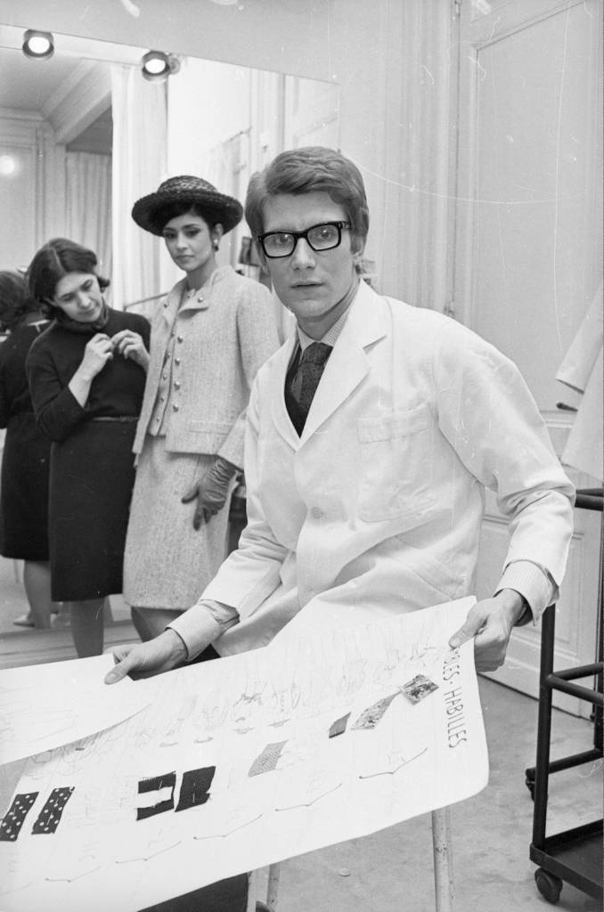 7th April 1965:  Yves Saint-Laurent, ex-wonder boy of Dior, working at his own fashion house in Paris.  (Photo by Reg Lancaster/Express/Getty Images)