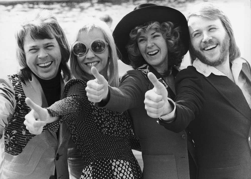 Swedish pop group ABBA give the thumbs up after winning the Eurovision Song Contest with their song 'Waterloo', Brighton, 7th April 1974. Left to right: Bjorn Ulvaeus, Agnetha Faltskog, Anni-Frid Lyngstad and Benny Andersson. (Photo by Steve Wood/Daily Express/Hulton Archive/Getty Images)