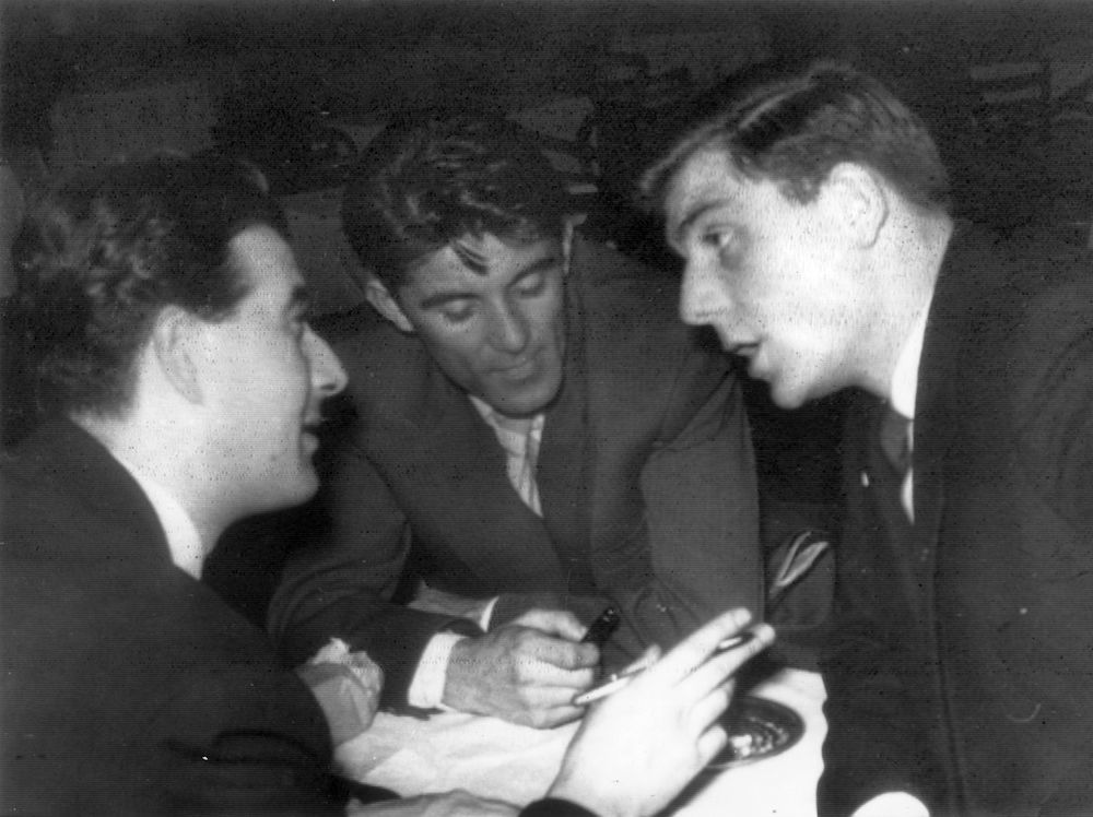 7th February 1958:  Manchester United footballer Duncan Edwards is interviewed by two Yugoslav journalists in Belgrade.  (Photo by Keystone/Getty Images)