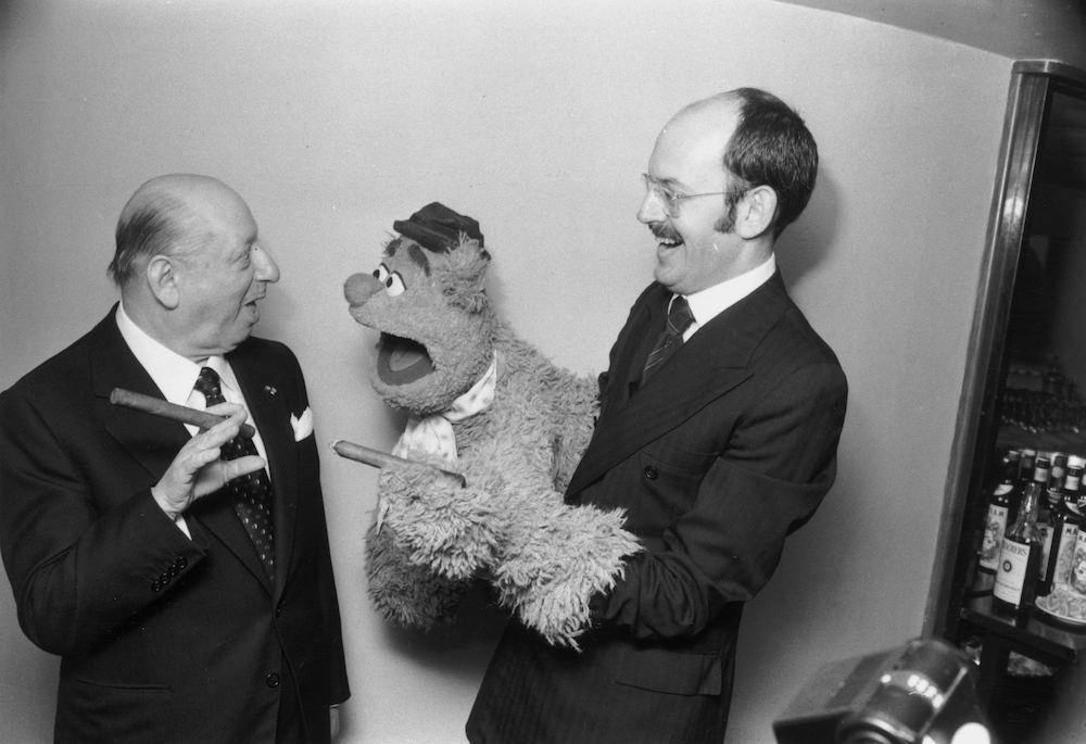 7th February 1978:  Lord Grade (1906 - 1998) (Baron Grade of Elstree) meets Fozzie Bear from the award winning Muppet Show at The Variety Club of Great Britain Show Business Awards luncheon held at the Savoy Hotel, London.  (Photo by Malcolm Clarke/Keystone/Getty Images)