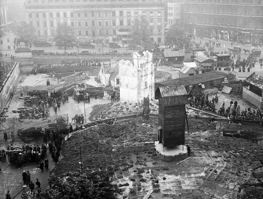 7th October 1918:  A mock village and a ruined building in the 'Feed the Guns' campaign in Trafalgar Square, London  (Photo by A. R. Coster/Topical Press Agency/Getty Images)